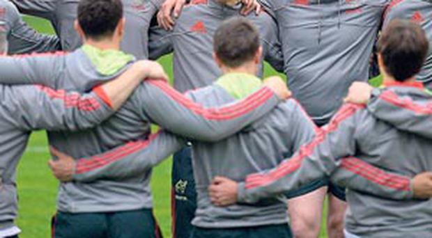 The Munster players and management gather for a team talk at Montpellier yesterday – they'll have to show all their renowned battling qualities to get a result today