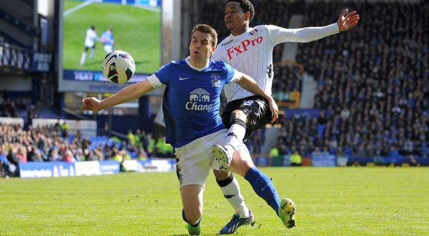 Everton's Seamus Coleman battles for the ball with Fulham's Urby Emanuelson during the Barclays Premier League match at Goodison Park
