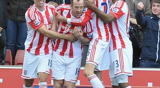 Stoke City's Charlie Adam 2nd left, is congratulated on scoring his teams goal during the Barclays Premier League match at the Britannia Stadium