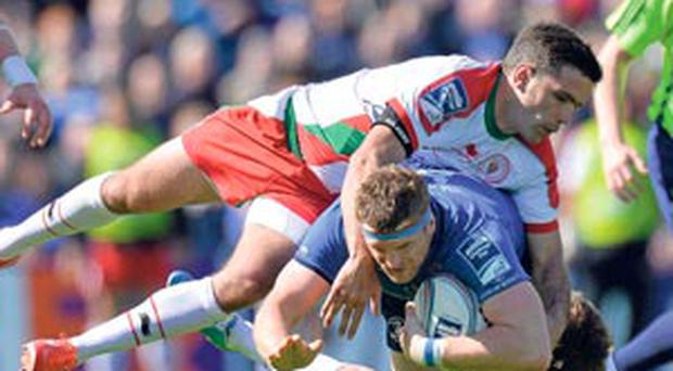 Jamie Heaslip is tackled by Dimitri Yachvili and Yann Lesgourues at the RDS yesterday.
