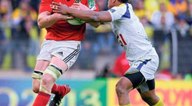 Paul O'Connell is tackled by Wesley Fofana during yesterday's Heineken Cup semi-final in Montpellier.