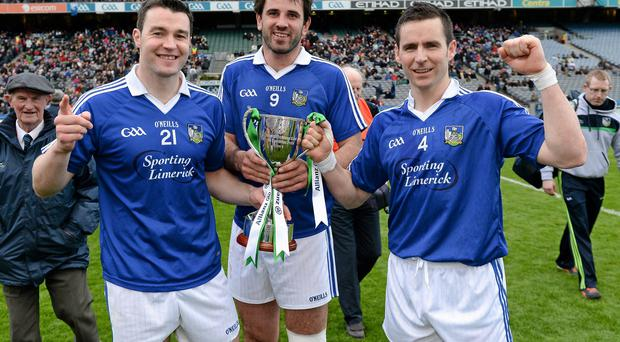 Stephen Lucey, John Galvin and Mark O'Riordan celebrate with the cup after the game.