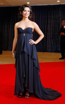 Actress Morena Baccarin arrives on the red carpet at the annual White House Correspondents' Association dinner in Washington