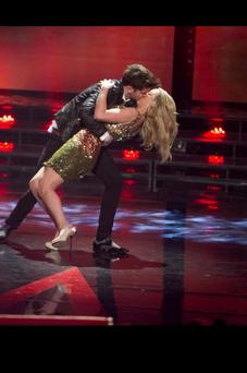Voice of Ireland co-presenter Eoghan McDermott planted a Hollywood kiss on Kathryn Thomas