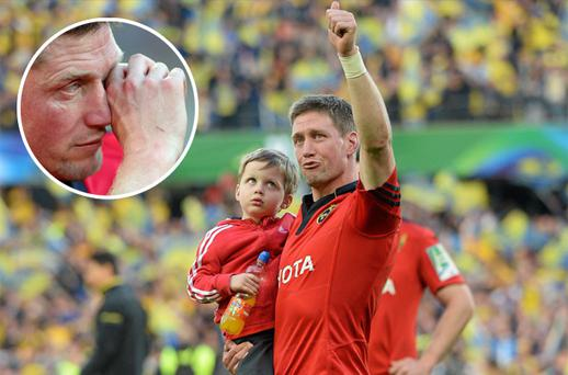 Ronan O'Gara, carrying his son Rua, salutes the Munster supporters after their Heineken Cup semi-final defeat to Clermont