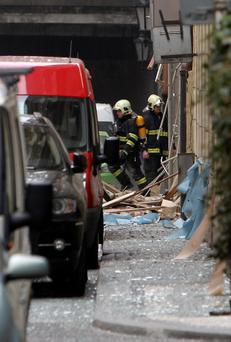 Firefighters search an area after the explosion in Prague