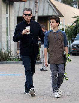 Pierce Brosnan and his son Paris (12) enjoy a stroll in Malibu, California