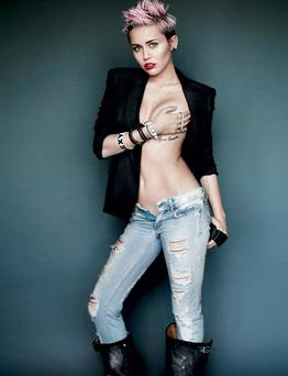 Miley poses in a series of sultry shots for the latest issue of V. Picture: Mario Testino/V Magazine