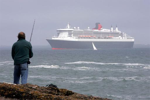 Cunard's Queen Mary 2, pictured on a visit to Waterford, will dock in Dun Laoghaire on May 16, heralding visits by an expected 30,000 passengers in 2013