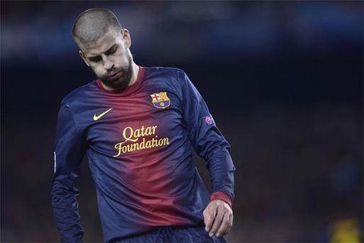 Barcelona defender Gerard Pique reacts during the Champions League semifinal second leg soccer match between FC Barcelona and Bayern Munich at the Camp Nou