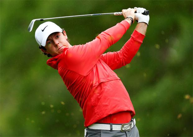 Rory McIlroy watches his tee shot on the sixth hole during the first round of the Wells Fargo Championship PGA golf tournament