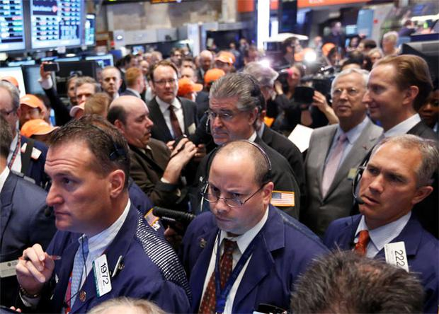 raders work on the floor at the NYSE