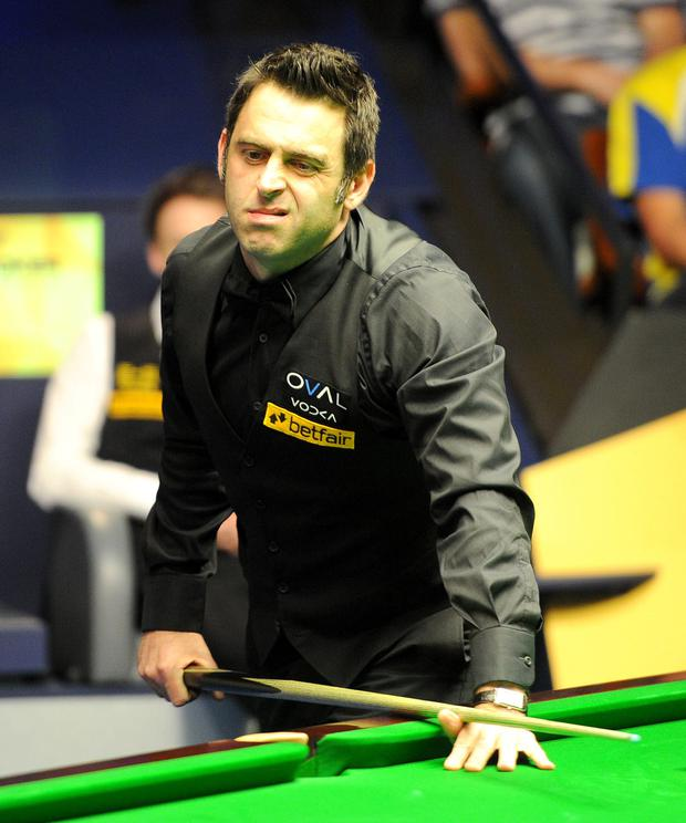 Ronnie O'Sullivan reacts after a shot during his match against Judd Trump, during the Betfair World Championships at the Crucible