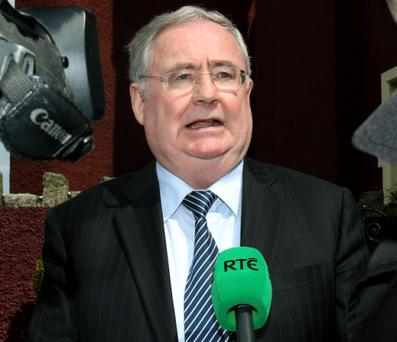 Pat Rabbitte, Minister for Communictions and Natural Resources talks to media before going on to address the Postmaster's Union at Fitzptrick's Hotel, Killiney.