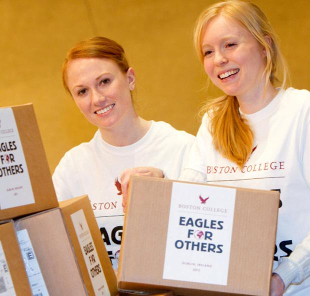 Volunteers Aoife Mattei and Meghan Donaldson are pictured packing some of the boxes at the event.