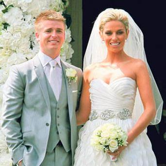'BREATH-TAKING': Pippa O'Connor, wearing the Monique Lhuillier-designed dress, with Brian Ormond after their wedding at St Patrick's Church, Curtlestown, Co Wicklow in June 2011.