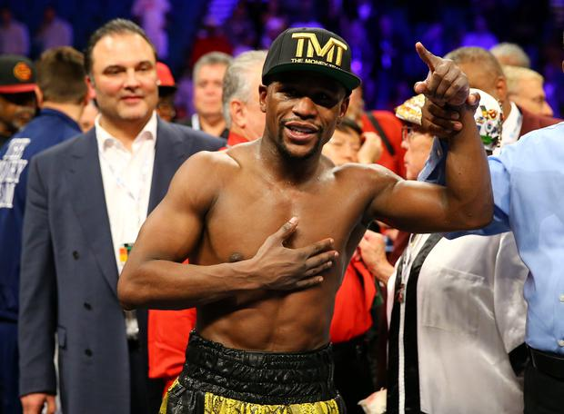 Floyd Mayweather Jr. celebrates his unanimous decision victory against Robert Guerrero in their WBC welterweight title bout at the MGM Grand