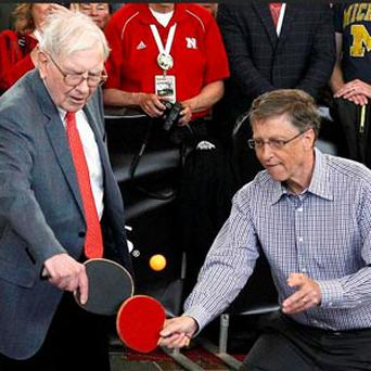 Berkshire Hathaway CEO Warren Buffett plays table tennis with Microsoft Chairman Bill Gates in Omaha, the day after company's annual meeting.