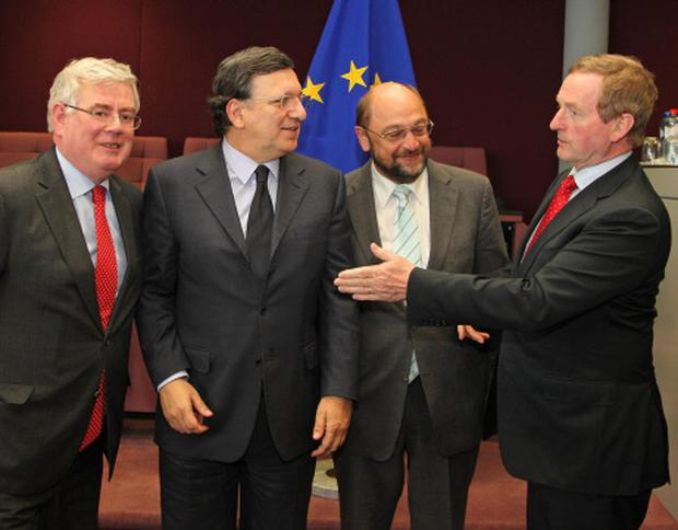 European Commission President Jose Manuel Barroso, second left, with Enda Kenny, right, European Parliament President Martin Schulz, second right and Eamon Gilmore, left, at the European Commission headquarters in Brussels.