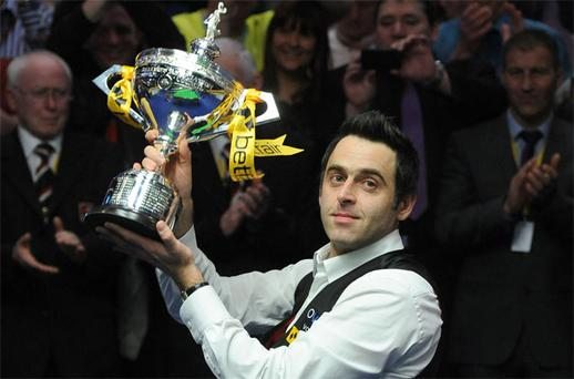 Ronnie O'Sullivan celebrates with the trophy after beating Barry Hawkins in the final of the Betfair World Championships at the Crucible earlier this year