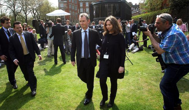 Deputy Speaker of the House of Commons and MP for Ribble Valley Nigel Evans arrives with an unidentified woman to make a statement in Westminster today about his arrest at the weekend.