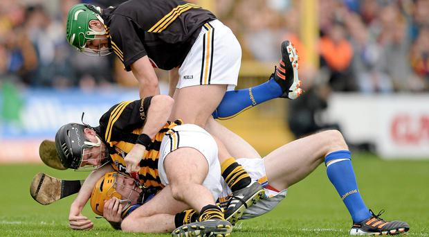 Kilkenny's JJ Delaney and goalkeeper Eoin Murphy tussle with Lar Corbett resulting in both Delaney and Corbett being sent off.
