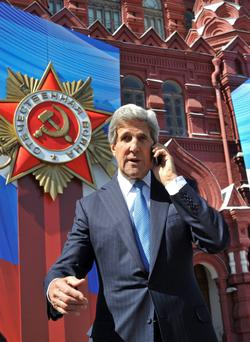 U.S. Secretary of State John Kerry speaks on his mobile phone at the Red Square