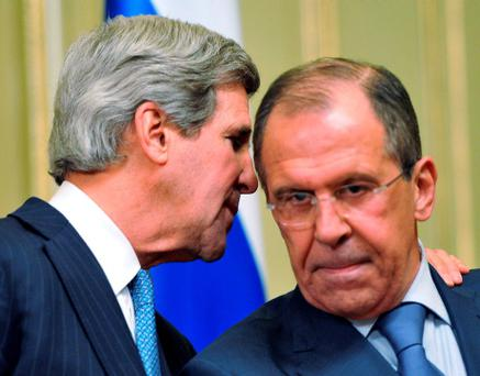 U.S. Secretary of State John Kerry (L) whispers to Russian Foreign Minister Sergei Lavrov during a joint news conference after their meeting in Moscow. Photo: Reuters