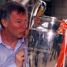 Manchester United manager Alex Ferguson gives the European Champions League Cup a big kiss in Barcelona
