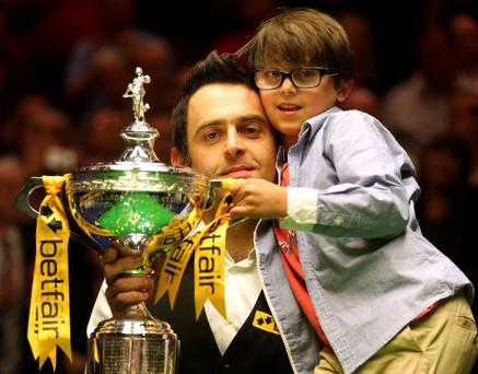 Ronnie O'Sullivan and his son Ronnie jr after last year's win at the Crucible