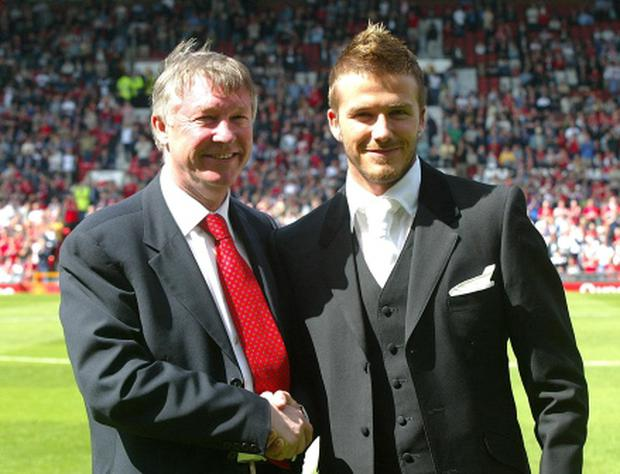 David Beckham (right) with manger Alex Ferguson in 2002