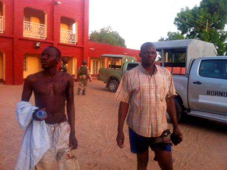 Injured policemen are seen outside Shehu's Palace of Bama, Maiduguri, Borno State, Nigeria