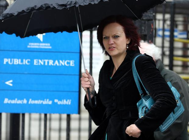 Justyna Raducha, of Boroimhe Cherry, Swords, Dublin, leaving court after her Civil Court action for damages.