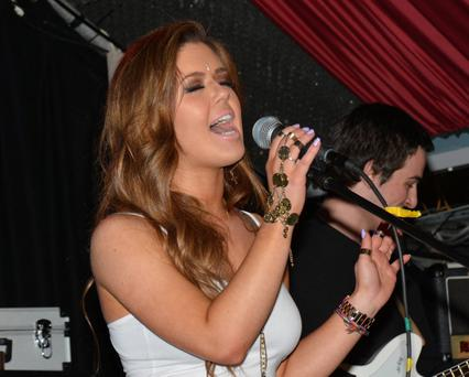Bonnie Ryan performs with her band at Grand Social Bar