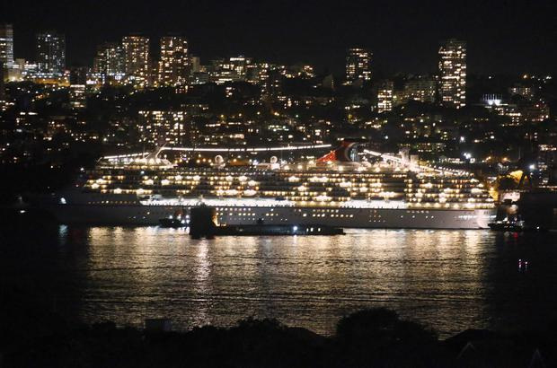 The Carnival Spirit sails out of Sydney Harbour