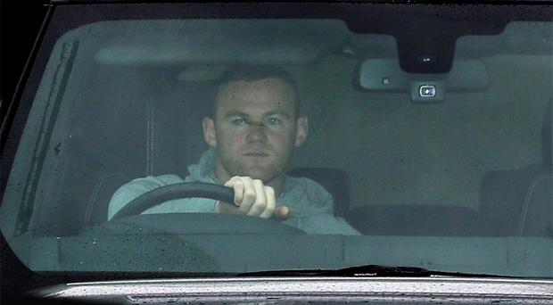 Wayne Rooney waits in traffic as he arrives at Manchester United's Carrington Training Ground