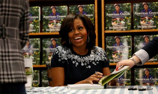 Michelle Obama signs copies of her book, 'American Grown: The Story of the White House Kitchen Garden and Gardens Across America', in Washington