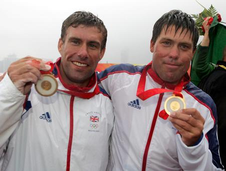 Andrew Simpson (right) and Iain Percy, celebrate after winning the Gold Medal in their class at the 2008 Beijing Olympic Games