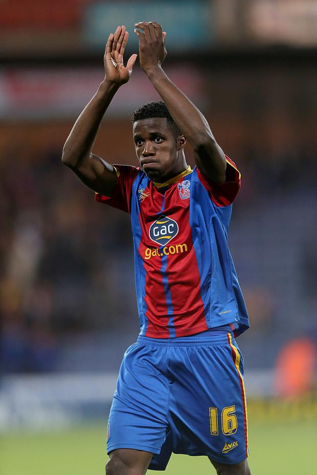Crystal Palace's Wilfried Zaha acknowledges the fans after his final match at Selhurst Park