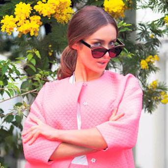 Roz Purcell models peak rim sunglasses (€27), pink neon jacket (€68), pink neon short (€48), white tee (€12), all from Topshop.