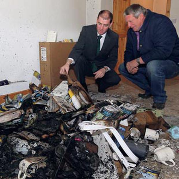 Paul Kehoe TD and Fine Gael county councillor Larry O'Brien at Mr Kehoe's office in New Ross, Co Wexford which was broken into