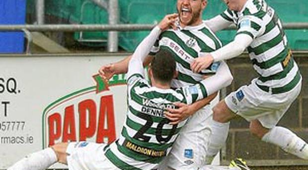 James Chambers, Shamrock Rovers, celebrates after scoring his side's first goal with team-mates Billy Dennehy, left, and Daniel Ledwith, right.
