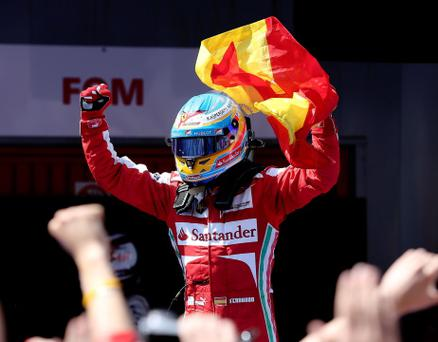 Ferrari's Fernando Alonso celebrates his victory in the Spanish Grand Prix