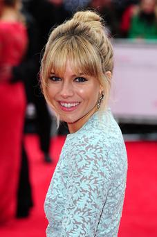 Sienna opted for a a soft top knot and smokey eyes for the red carpet occasion.