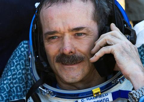 Canadian astronaut Chris Hadfield speaks on the phone after the Russian Soyuz space capsule landed some 150 km (90 miles) southeast of the town of Zhezkazgan, in central Kazakhstan May 14, 2013. REUTERS/Sergei Remezov