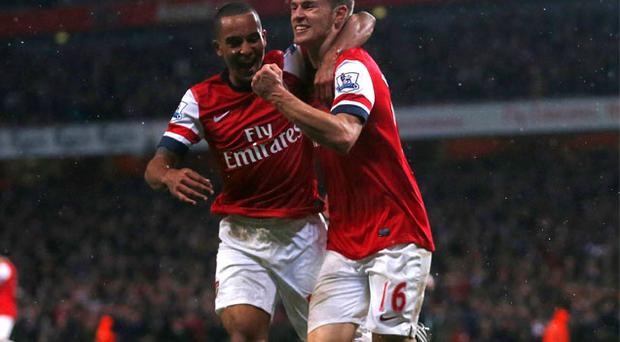Arsenal's Theo Walcott and Aaron Ramsey celebrate Ramsey's goal against Wigan
