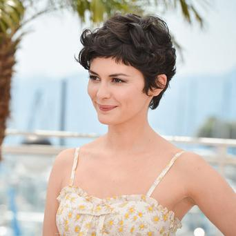 Audrey Tautou, mistress of ceremony of the 66th Cannes Film Festival, poses during a photocall on the eve of the opening of the Festival in Cannes May 14, 2013.