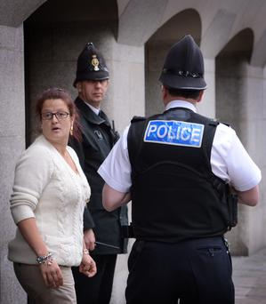 Natalie Sharp, mother of murdered school girl Tia Sharp leaves the Old Bailey in London after Stuart Hazell was sentenced to 38 years for her murder