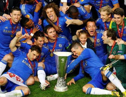 Chelsea's players celebrate with the trophy after defeating Benfica in their Europa League final soccer match at the Amsterdam Arena May 15, 2013.