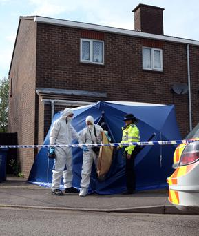 Police at the scene where the body of a two-year-old child has been found at a home after police were called to the address. Steve Parsons/PA Wire